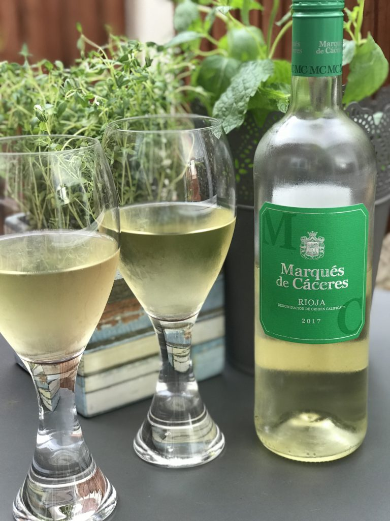 Marques de Caceres Blanco White wine with two glasses poured - thyme growing in the background