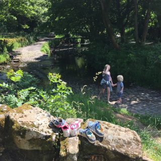 Kids paddling in the stream at Wycollar