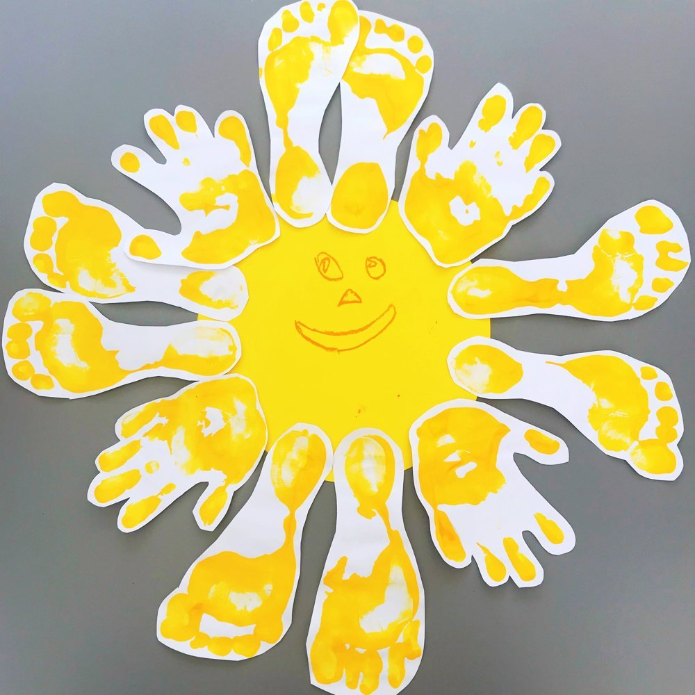 sunshine made from bright yellow hand and footprints