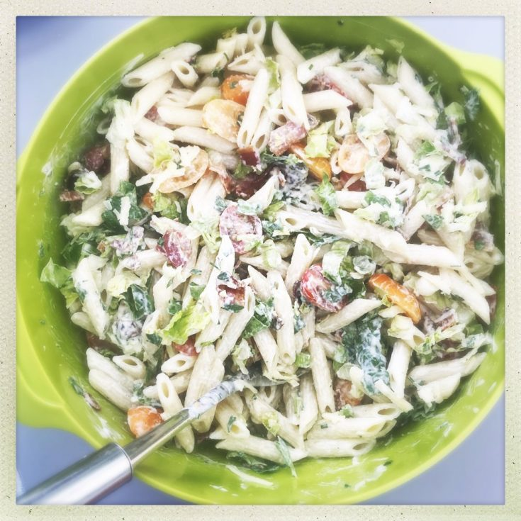 green joseph jospeh bowl filled with homemade BLT pasta salad with homemade ranch dressing