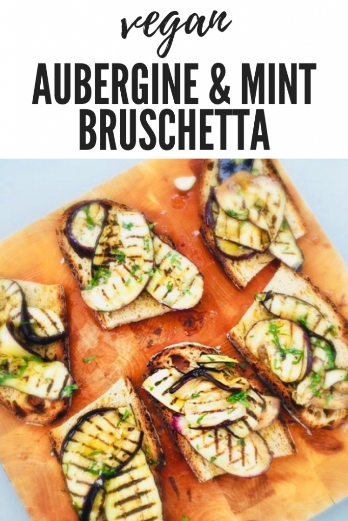 "aubergine and mint bruschetta made using sourdough toast, drizzled with olive oil - 6 slices on a wooden board. Text overlay ""vegan aubergine and min bruschetta"""