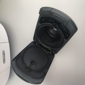 the pod holder on a Dolce Gusto coffee machine