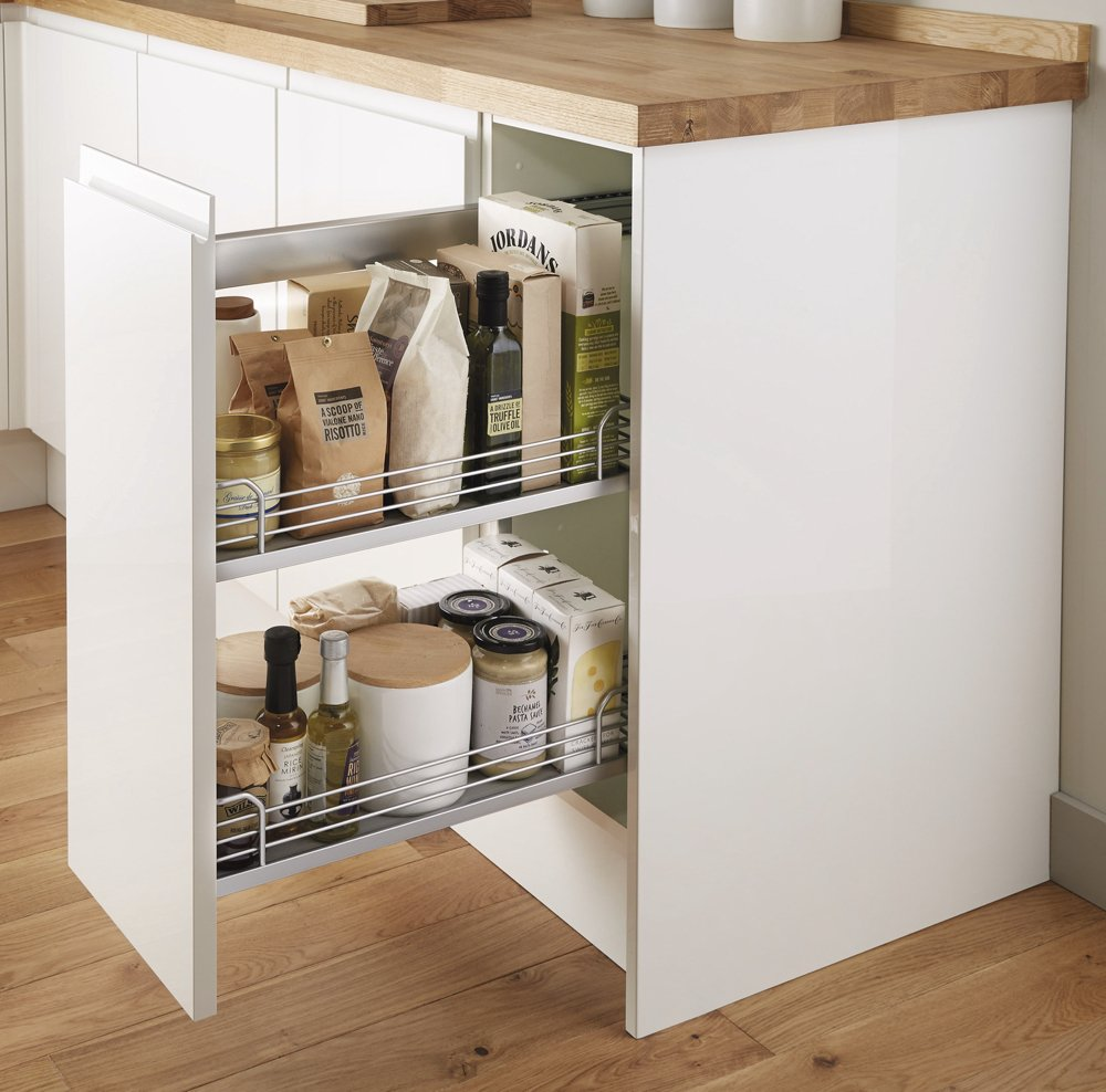 Howden Joinery Kitchen with slide out cupboard with basket storage