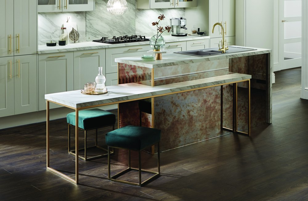 pale green kitchen with built in table and jade kitchen stools