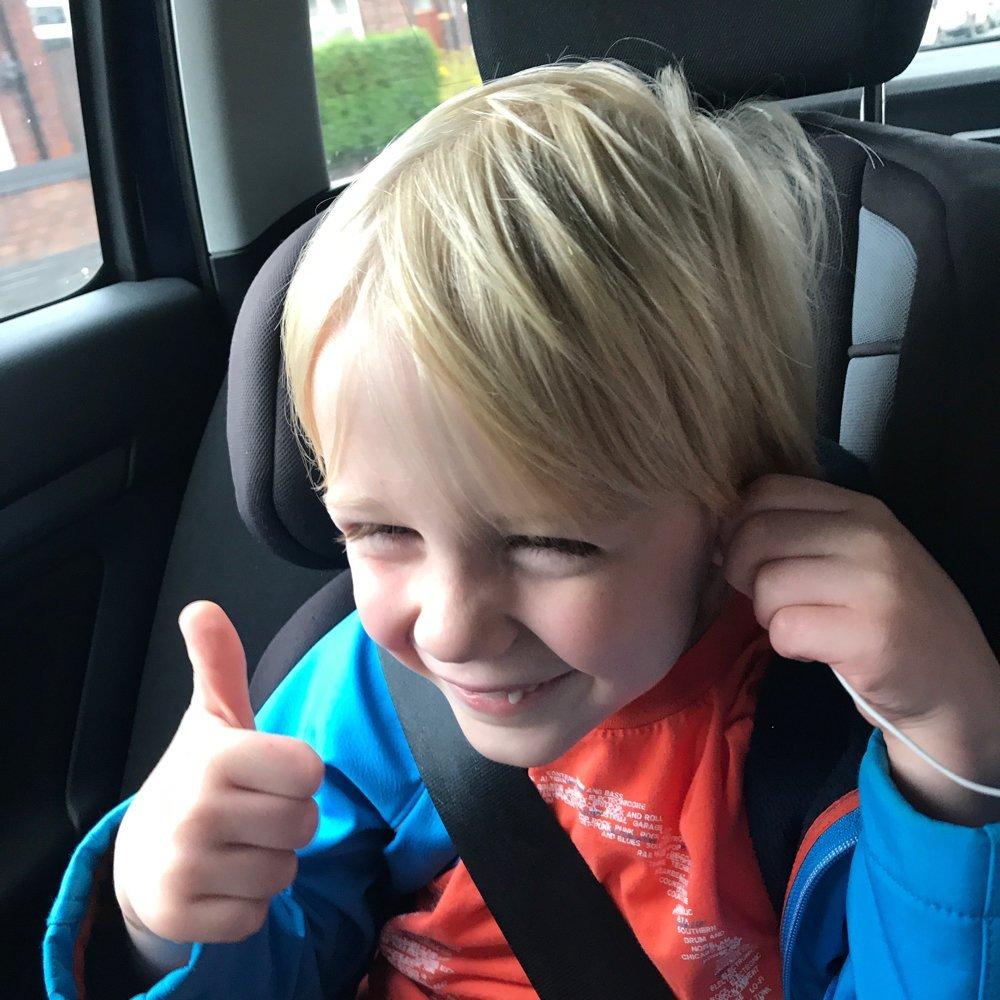 6 year old blonde boy sat in car seat