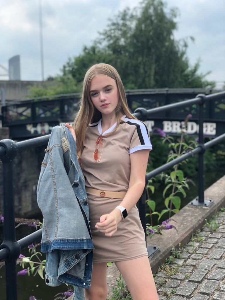blonde teenager on a canal bridge in Salford - wearing t-shirt dress and denim jacket