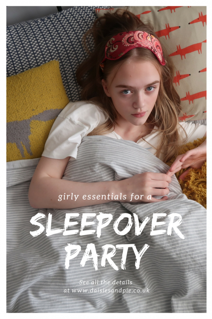 """teenage girl surrounded by loads of cushions and covers. Text overlay saying """"girly essentials for a sleepover party see more at www.daisiesandpie.co.uk"""""""