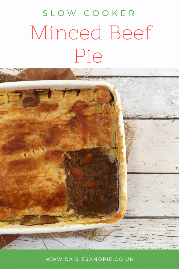 "enamel tray with homemade minced beef pie . Text overlay saying ""slow cooker minced beef pie"""