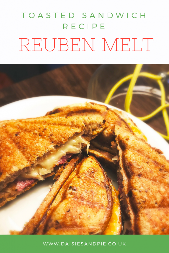 "plate of toasted reuben melt sandwiches. Text overlay saying ""toasted sandwich recipe - reuben melt"""