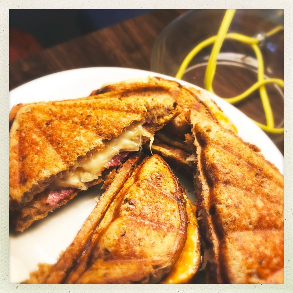 plate of toasted reuben melt sandwiches.