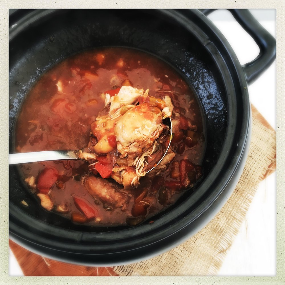 black crockpot filled with homemade rustic chicken casserole