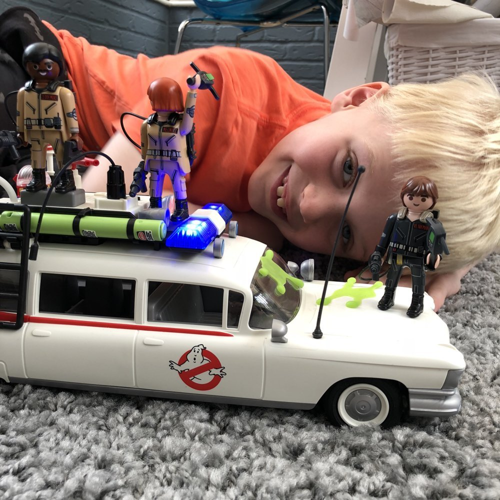 small boy playing with Playmobil Ghostbusters