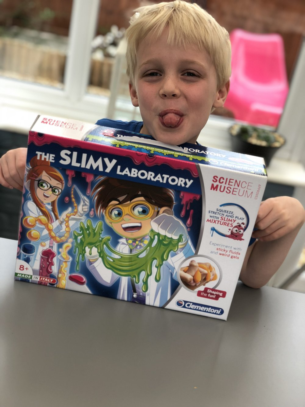 boy holding up the slimy laboratory box