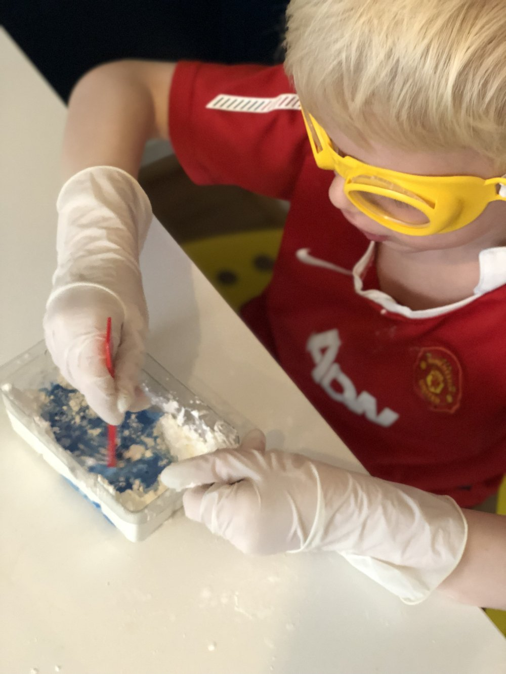 boy making blue plasticine with the Slimy Laboratory kit