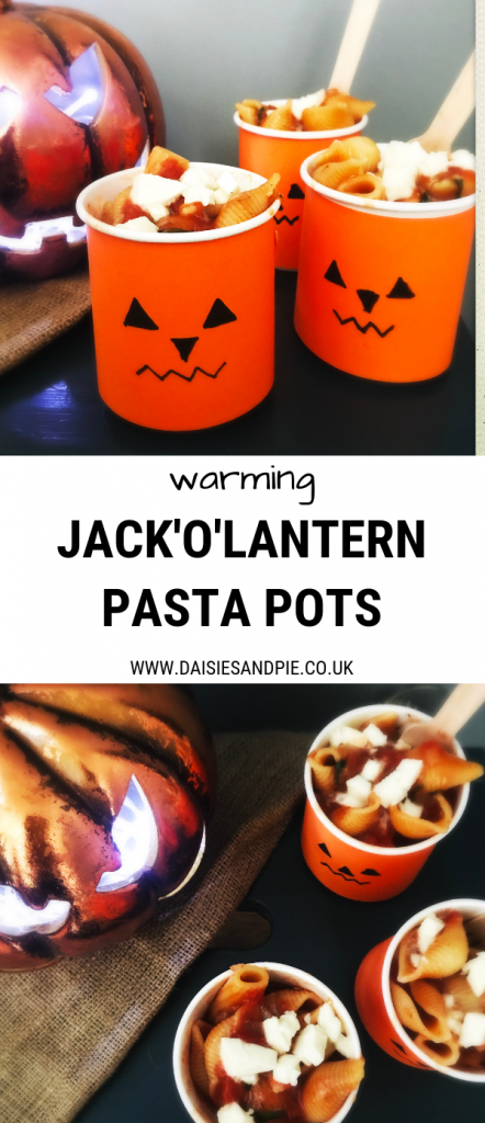 "jack o lantern pots filled with homemade vegetarian pasta with melted mozzarella . Text overlay saying ""warming - jack o lantern pasta pots"""