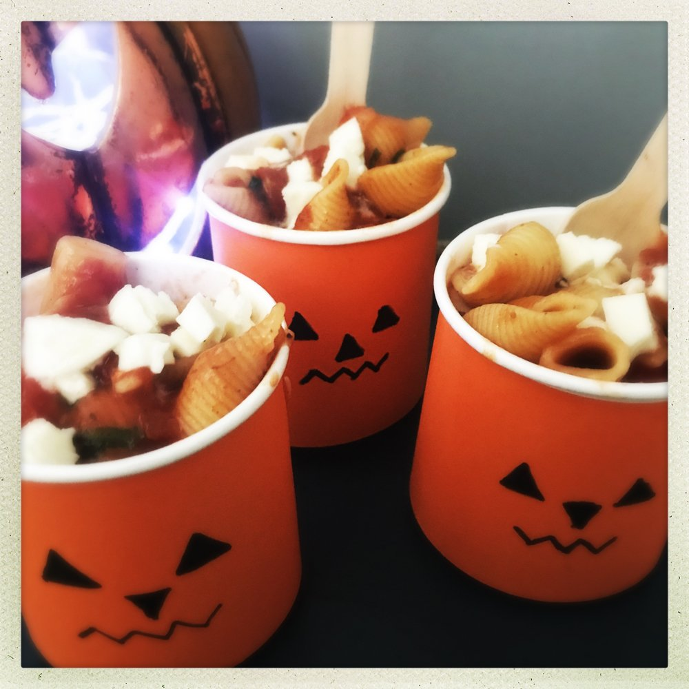 jack o lantern pots filled with homemade vegetarian pasta with melted mozzarella