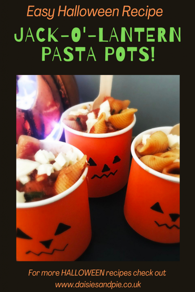 "jack p lantern pots filled with vegetarian pasta. Text overlay ""easy Halloween recipe - Jack O Lantern pasta pots"""