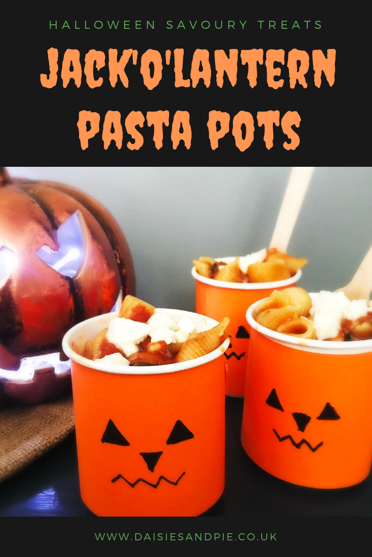 "jack o lantern pots filled with homemade vegetarian pasta with melted mozzarella . Text overlay saying ""Halloween savoury treats - jack o lantern pasta pots"""