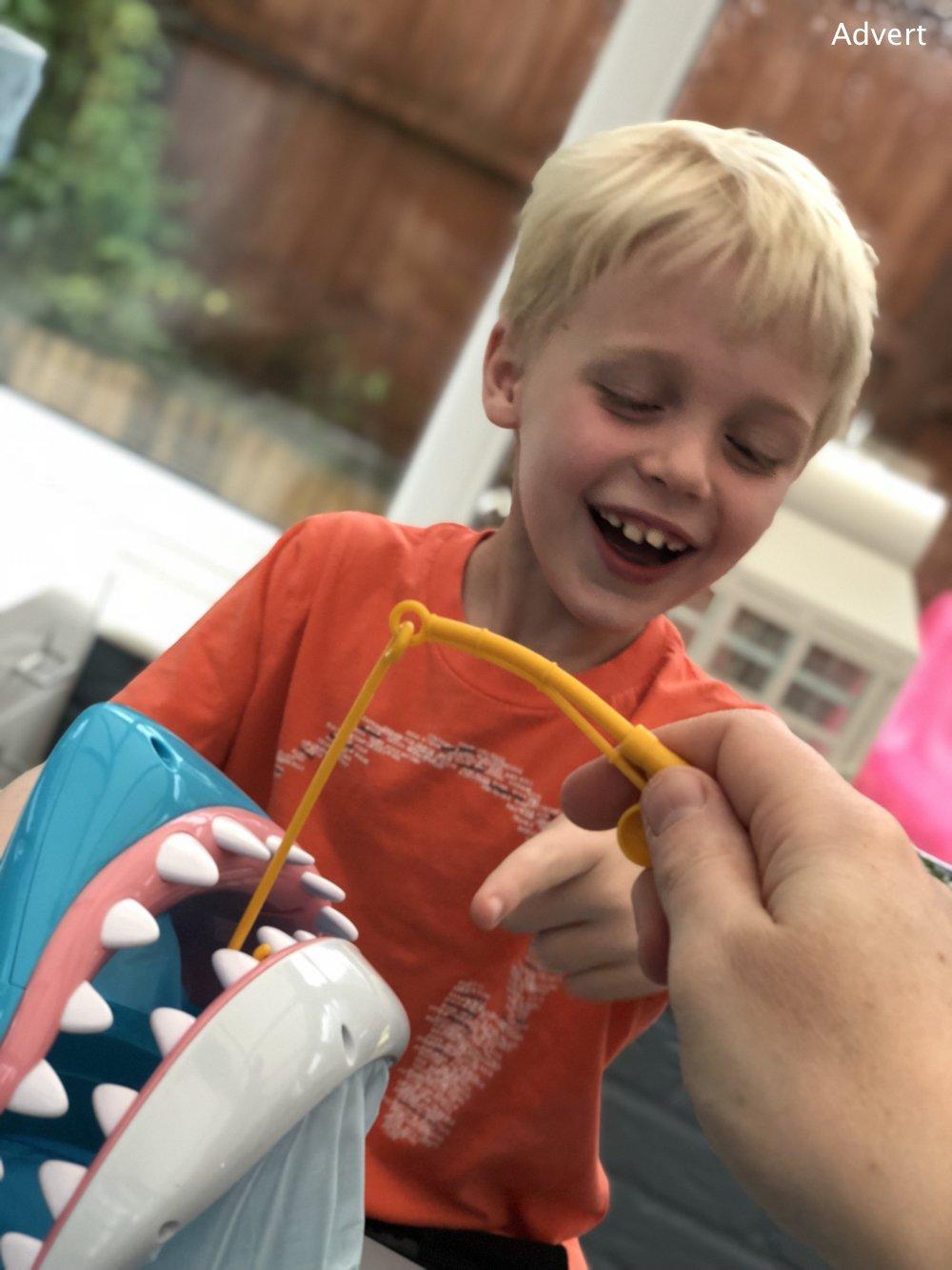 boy laughing playing shark bite game