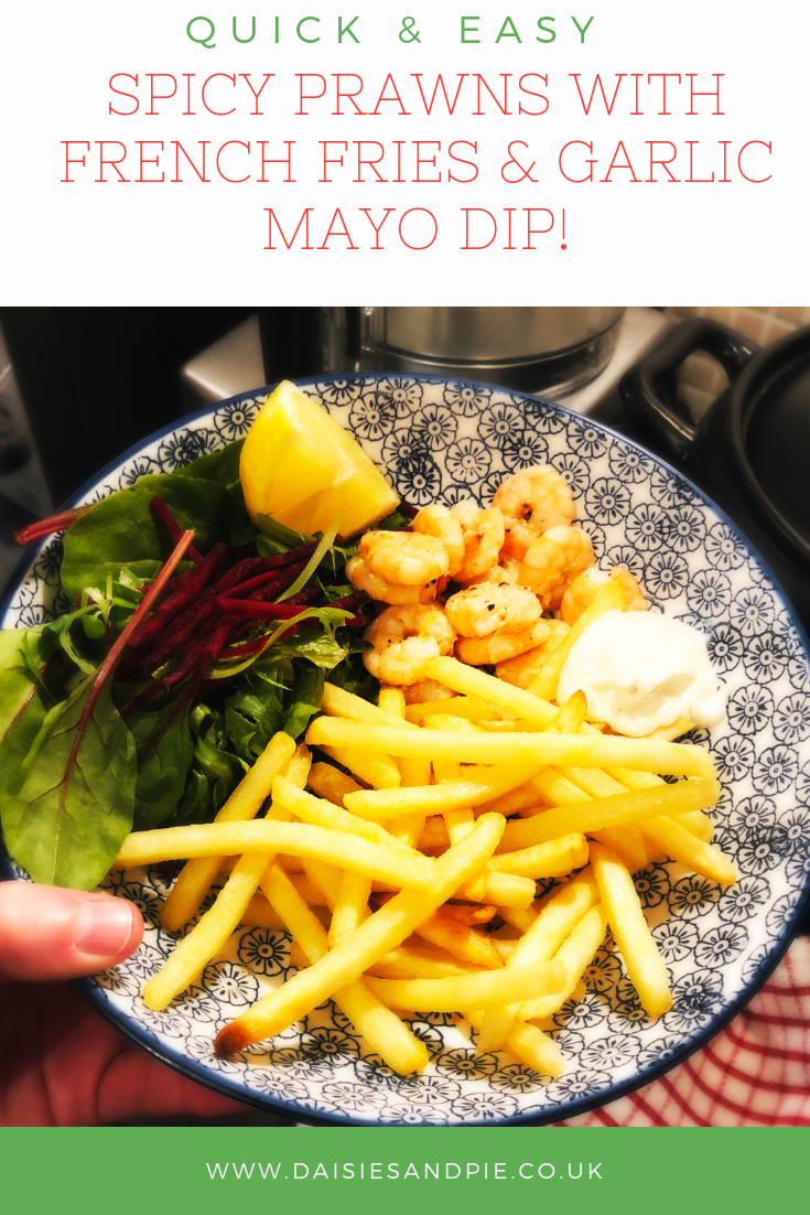 "blue and white print bowl filled with homemade spicy prawns with french fries, garlic mayonnaise dip and a bistro salad. Text overlay saying "" quick and easy spicy prawns with french fries and garlic mayo dip"""