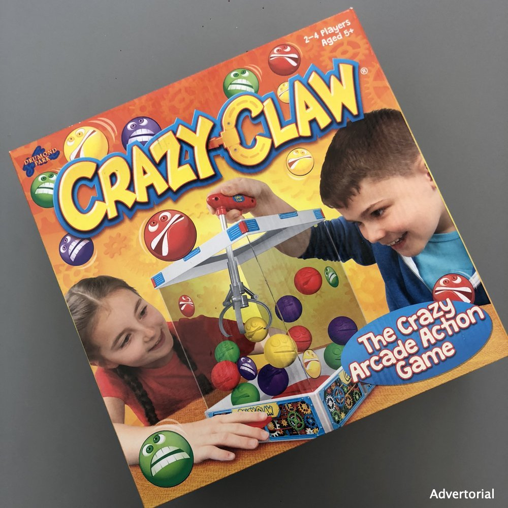 Crazy Claw game in the box on a grey desk