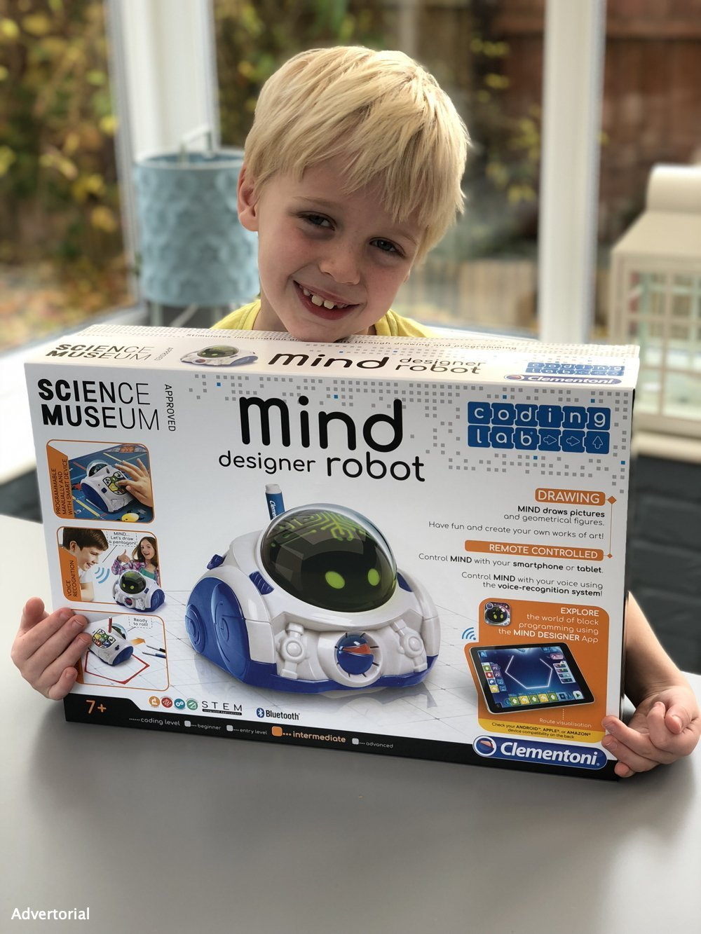 boy holding the Mind Designer Robot box