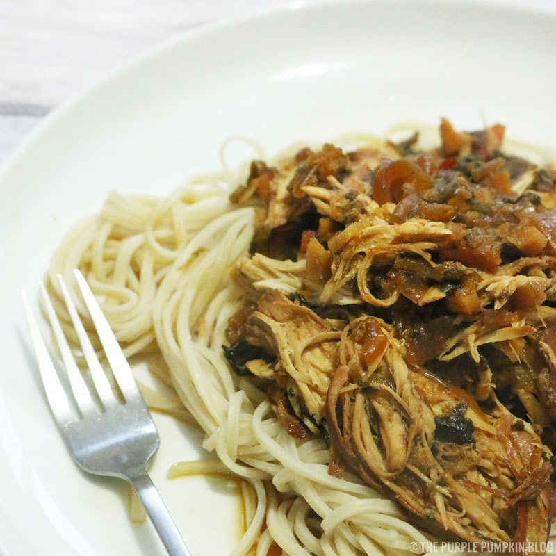 slow cooker chicken teriyaki served with noodles on a white plate