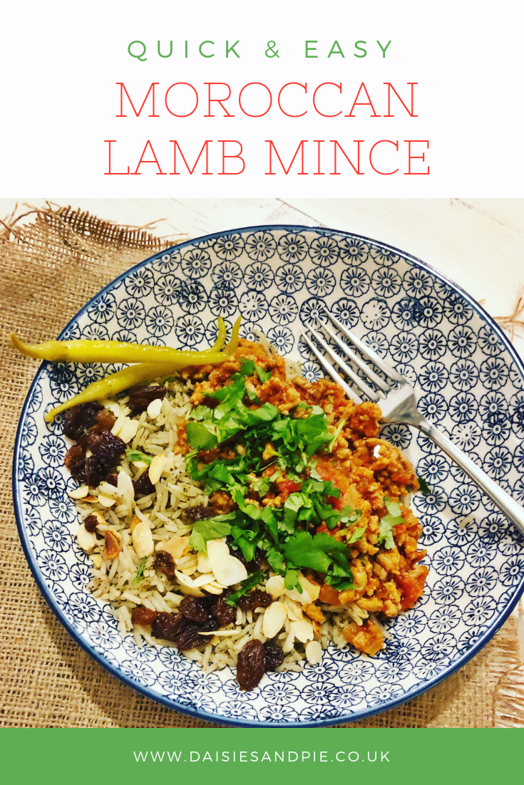 "blue and white bowl filled with Moroccan lamb mince, rice and scattering of almonds and raisins. Text overlay saying ""Quick and easy moroccan lamb mince"""