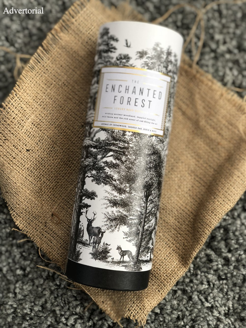 The Enchanted Forest Chase & Wonder reed diffuser in it's packaging