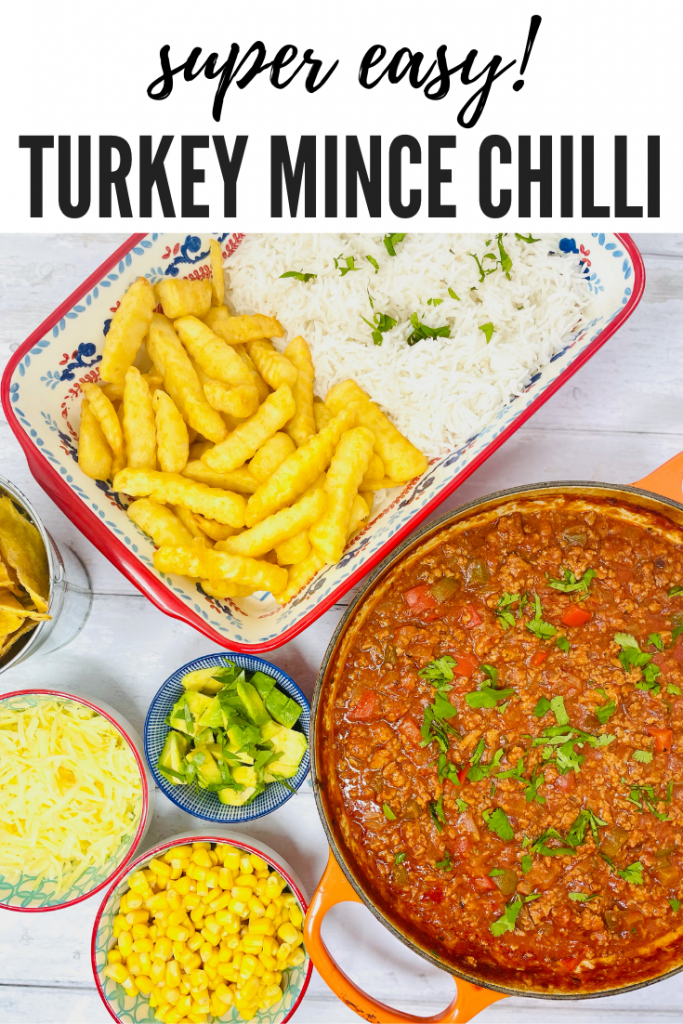 "turkey mince chilli served with side dishes of chips, rice, sweetcorn, grated cheese and chopped avocado. text overlay reads ""super easy turkey mince chilli"""
