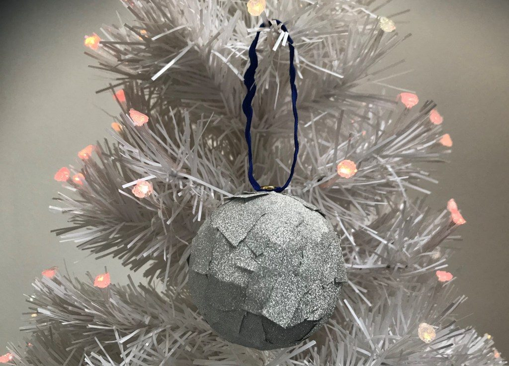 silver glittery tape bauble hung in silver Christmas tree