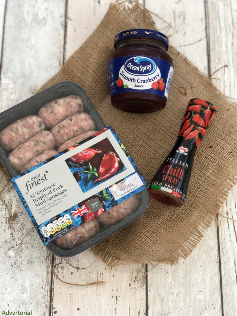 pack of mini toulouse pork sausages, Turci chilli seasoning spray, jar of ocean spray cranberry sauce
