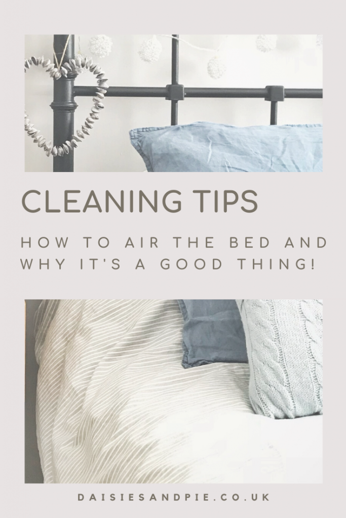 "cast iron bedstead made up with pale grey striped duvet and pale blue woollen pillows, purple shell heart hanging from the bed post. Text ""cleaning tips - how to air the bed and why its a good thing daisiesandpie.co.uk"""