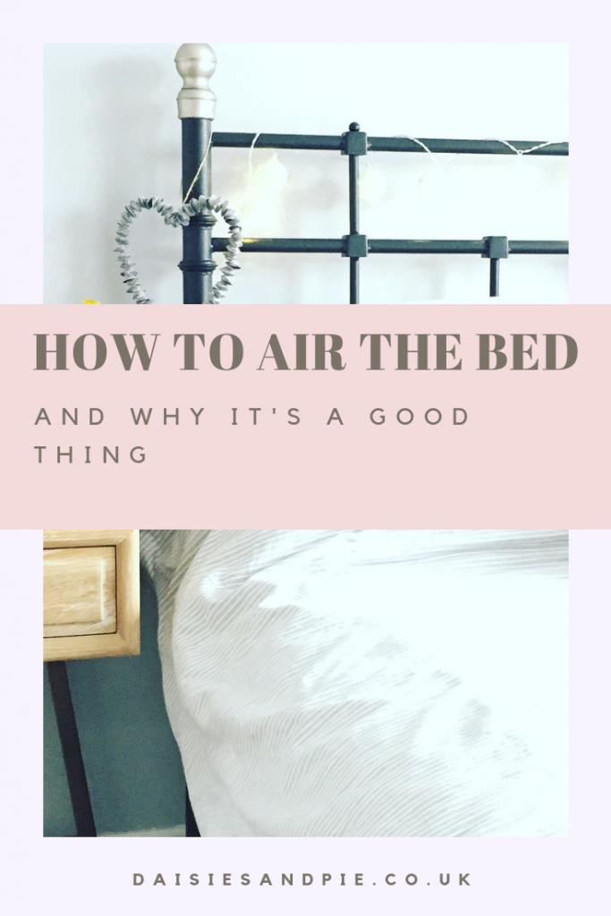 "iron bedstead made up with pale bed linen, shell love heart hung from the bed post. Text overlay saying ""how to air the bed and why its a good thing"""