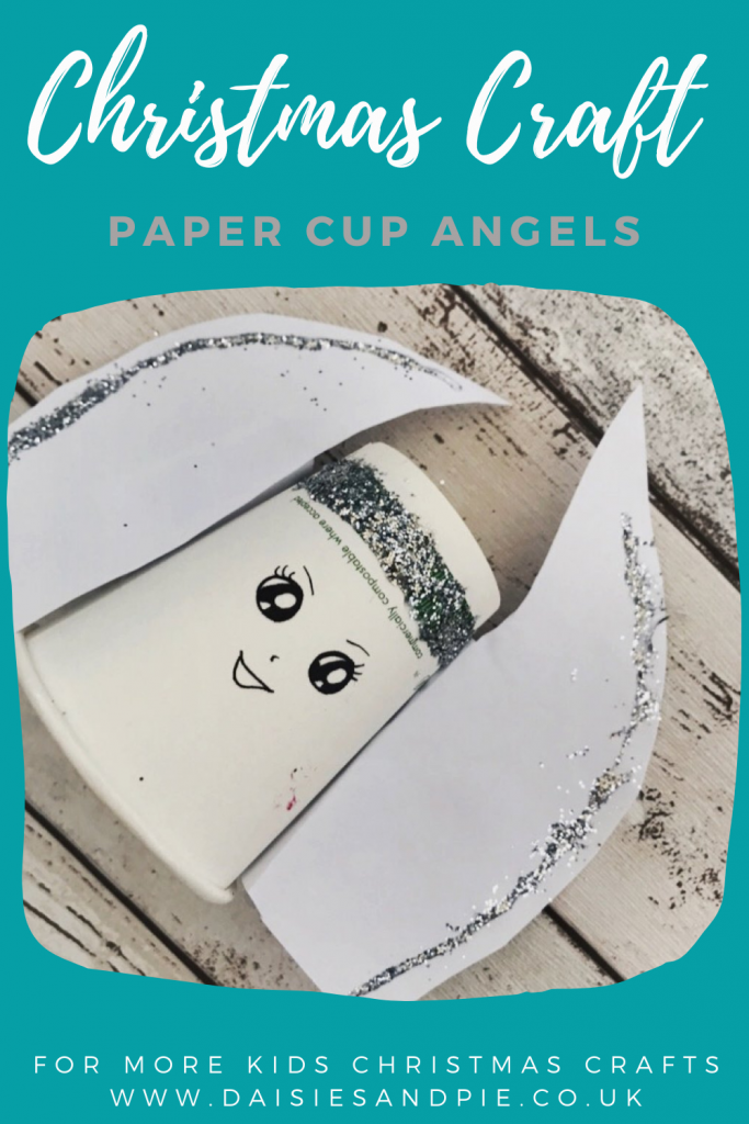 """angel made from paper cup, paper and glitter. Text overlay """"Christmas craft - paper cup angels, for more Christmas crafts - www.daisiesandpi.co.uk"""""""