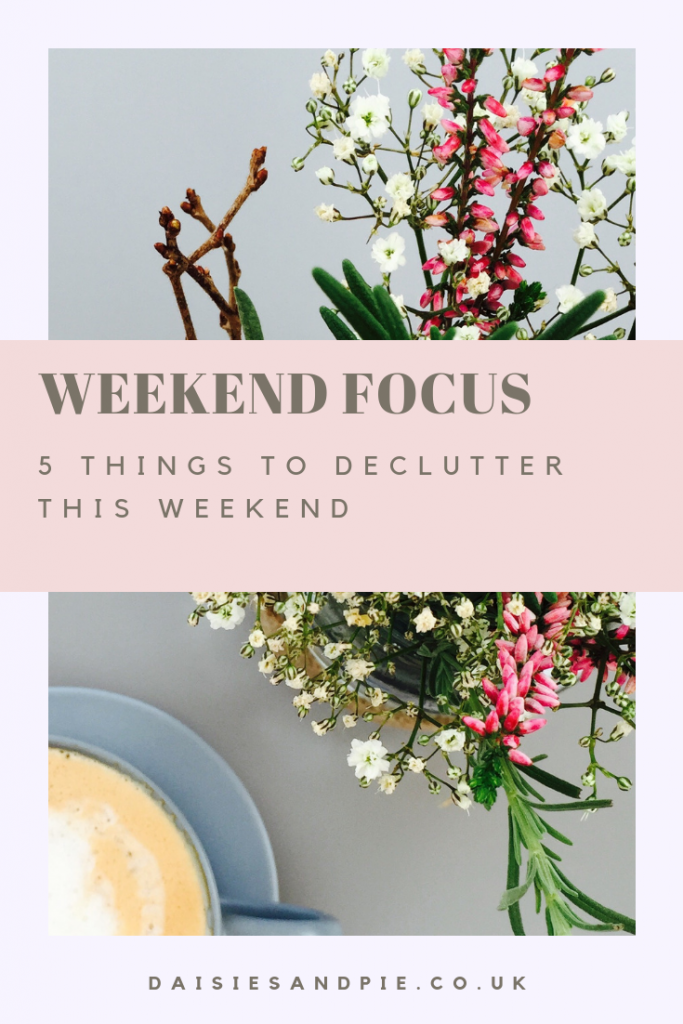 "vase of wild flowers alongside a cup of coffee. Text overlay saying ""weekend focus 5 things to declutter this weekend"""