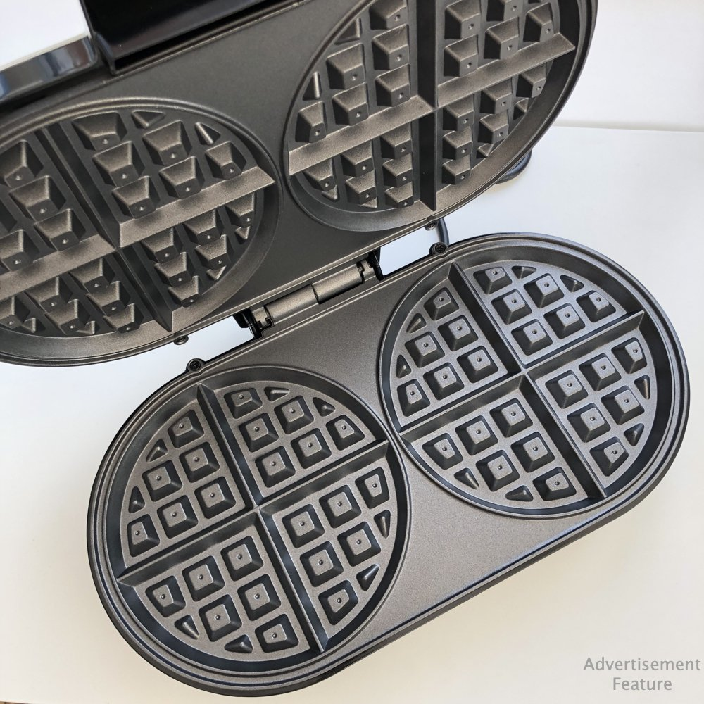 inside of the vonshef waffle maker showing the round waffle pans