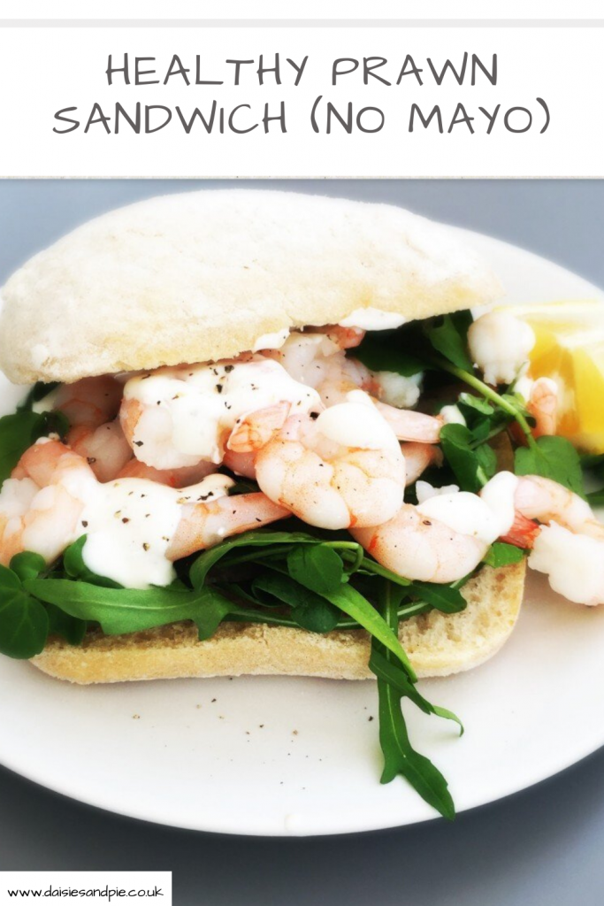 "ciabatta roll stuffed with baby leaf salad, king prawns and lemon pepper yogurt dressing. Text ""healthy prawn sandwich"""