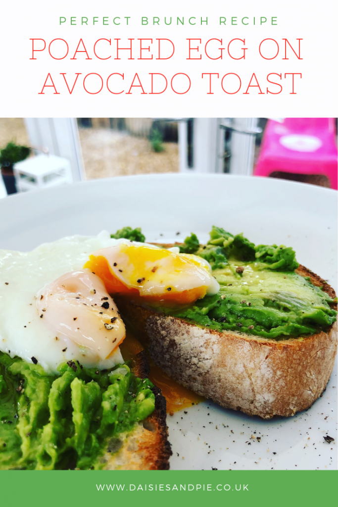 """two slices of sourdough toast topped with avocado a drizzle of olive oil and a poached egg. Text overlay saying """"perfect brunch recipe - poached egg on avocado toast - www.daisiesandpie.co.uk"""""""