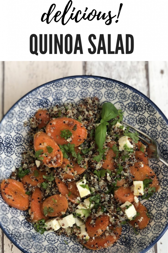 quinoa salad with roast carrots, feta cheese and herbs in a blue and white bowl.. text overlay reads 'delicious! quinoa salad'