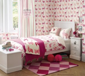 llama bedding from Laura Ashley with pink llama wallpaper and accessories