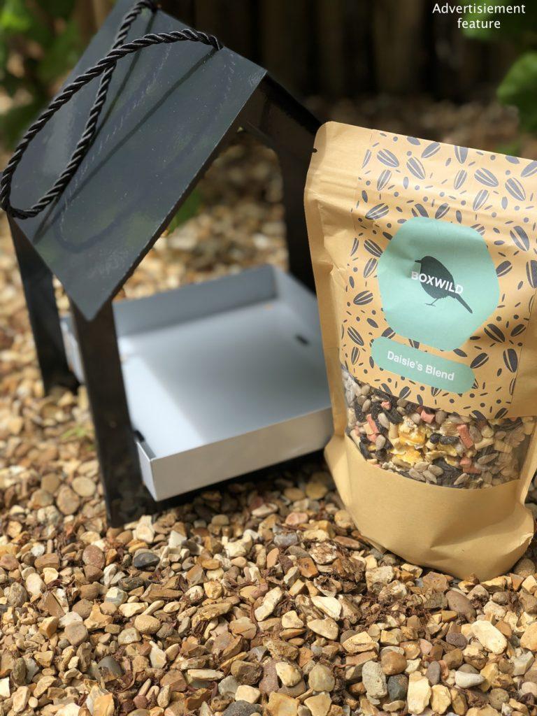Boxwild modern black and white bird house feeder alongside personalised hand blended luxury bird seed