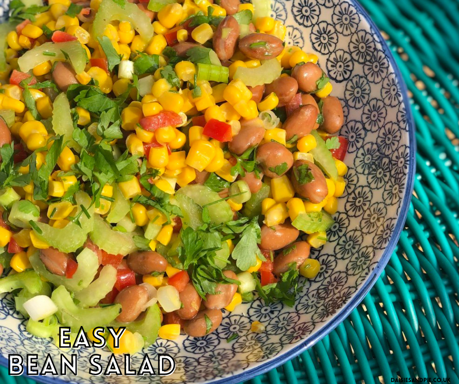 """mixed bean salad with corn and celery and herbs. Text overlay """"delicious easy bean salad"""""""