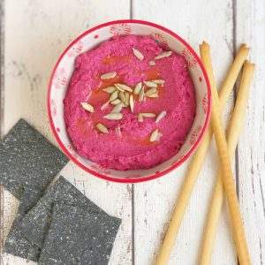 Beetroot hummus with sweet chilli kick served with charcoal and rye cracker bread and italian breadsticks.