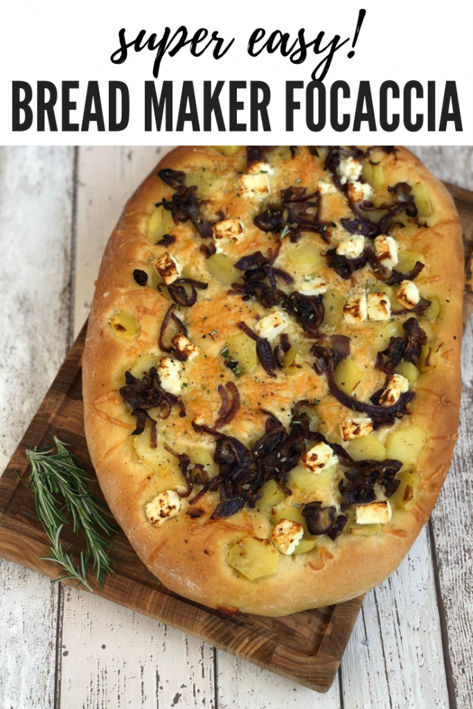 "homemade focaccia bread topped with cheese, potatoes and caramelised onions. Text overlay saying ""super easy bread maker focaccia"""