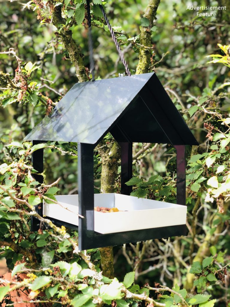 Boxwild modern black and white bird house feeder hung in the trees