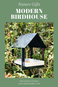 "Boxwild modern black and white bird house feeder hung in the trees. Text overlay saying ""gifts for nature lovers - modern bird house"""
