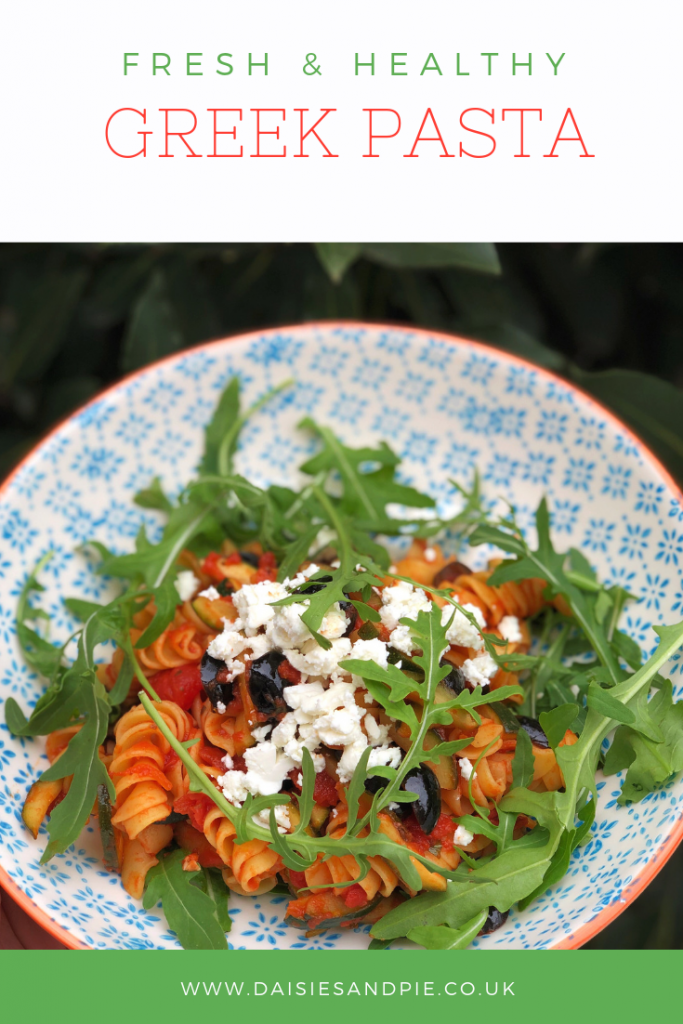 "bowl of homemade Greek pasta with olives, feta and rocket. Text overlay saying "" fresh and healthy Greek pasta"""