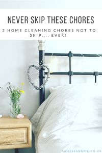 "beautifully clean bedroom with vase of fresh flowers by the bed. Text overlay ""Never skip these chores - 3 home cleaning chores not to skip - ever!"""