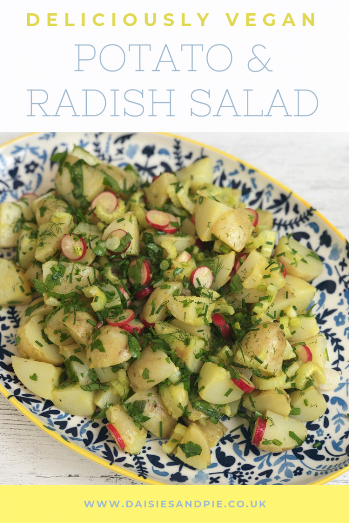 """platter of homemade potato and radish salad with herby olive oil dressing. Text overlay saying """"deliciously vegan potato and radish salad"""""""